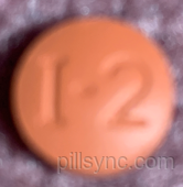 ROUND BROWN I2 ibuprofen  Ibuprofen 200 MG Oral Tablet